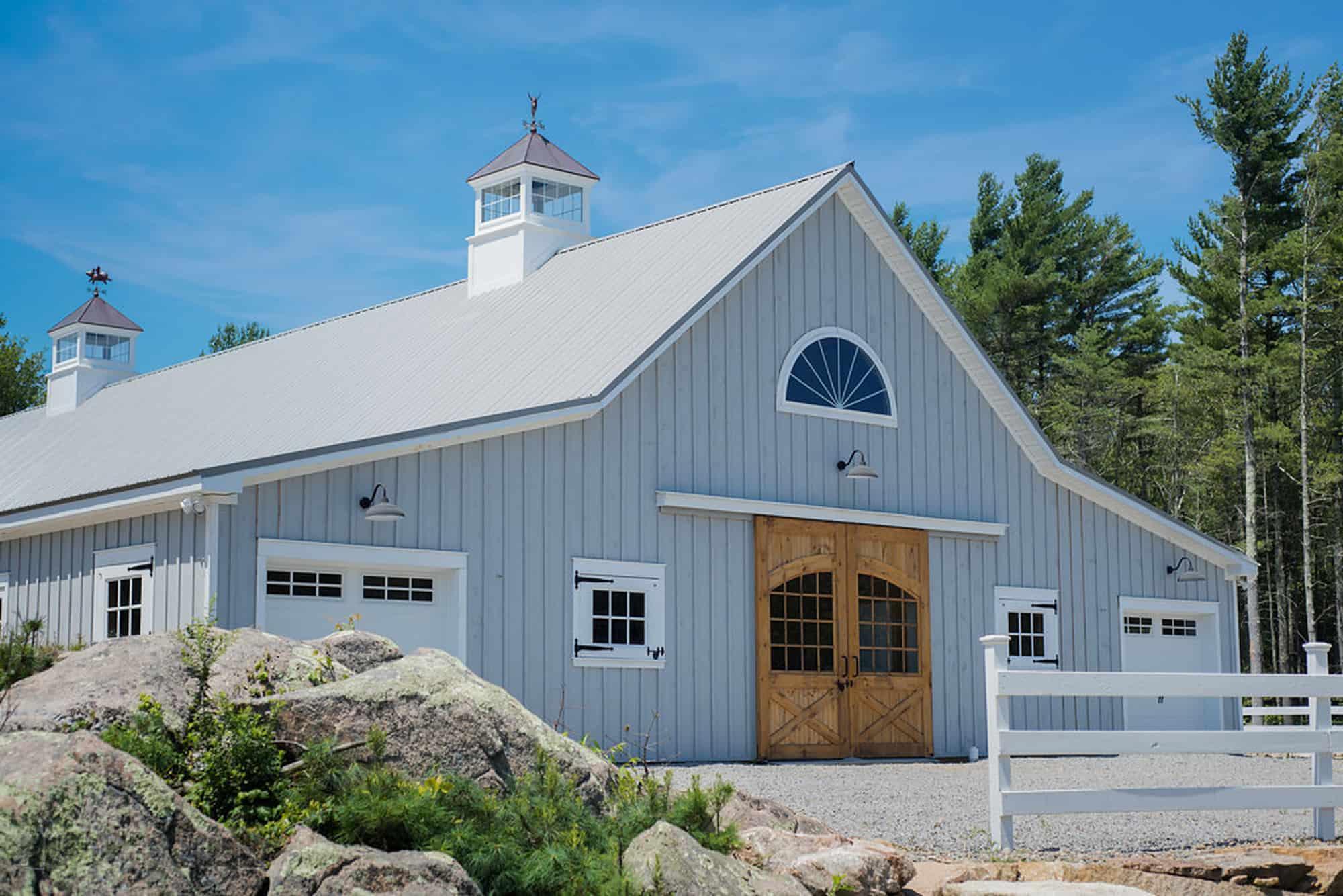 horse stalls cupola half circle window barn doors