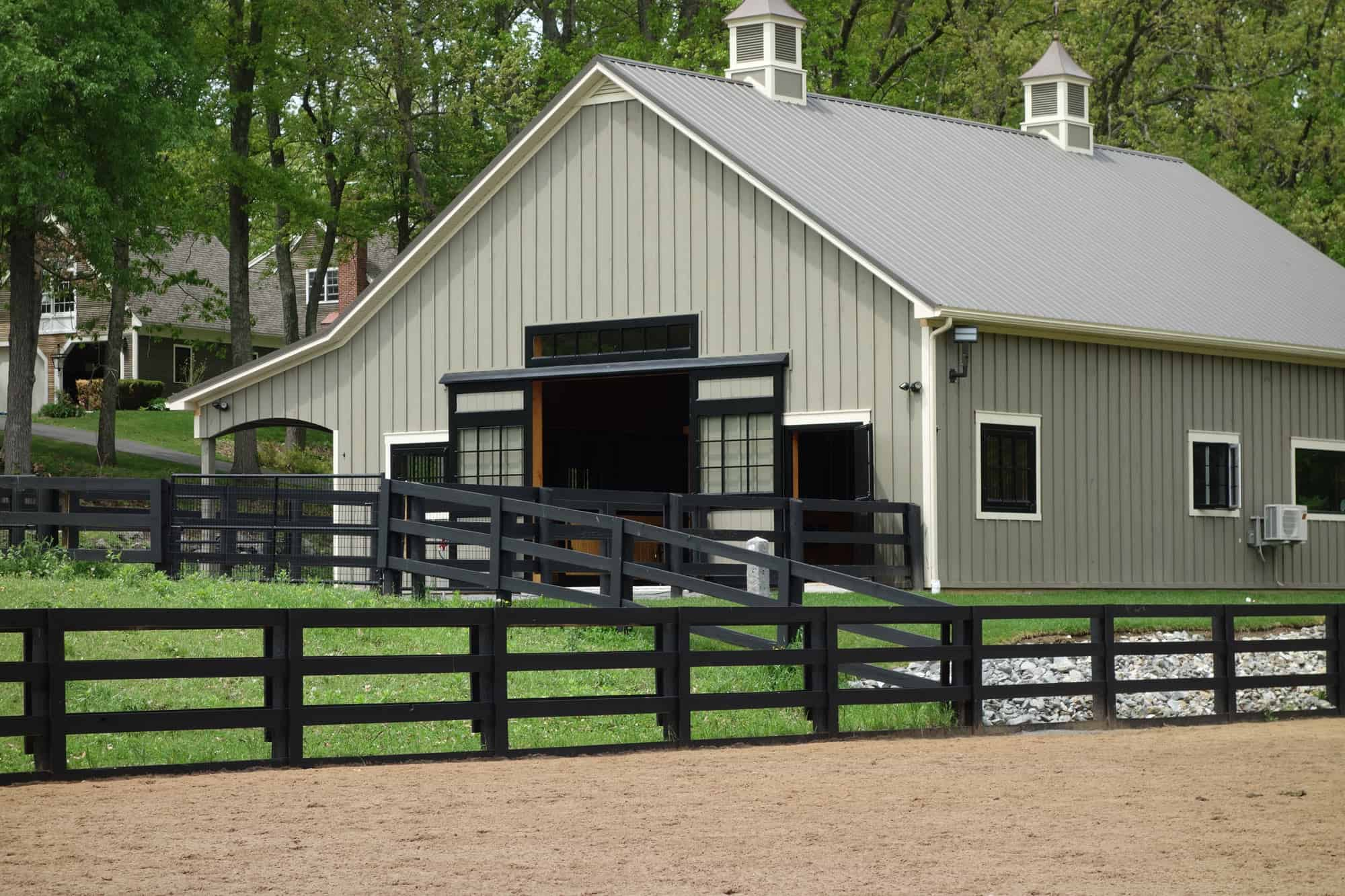cupola metal roof horse stalls black fence