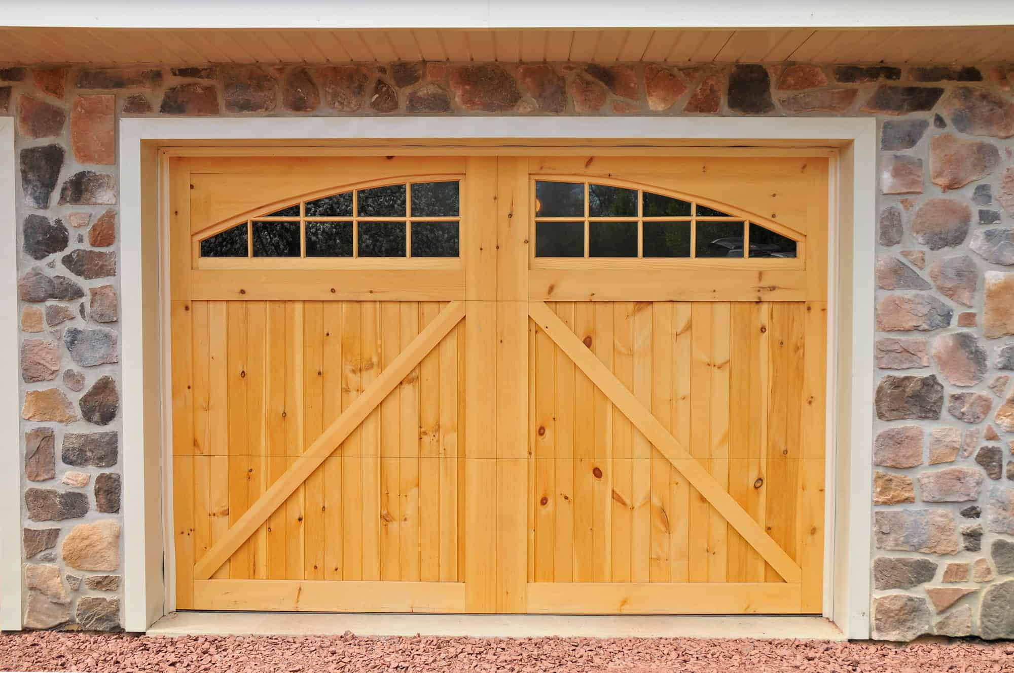 barn doors stonework garage with living quarters