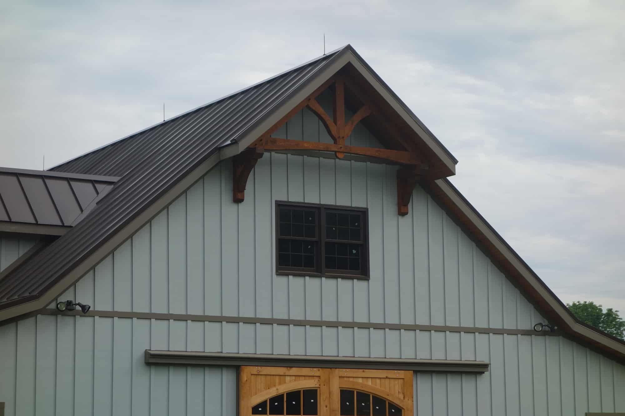 mass timber metal roof horse stalls