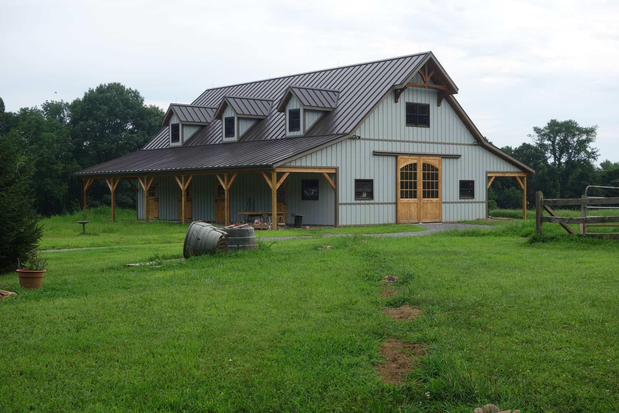 mass timber dormer windows metal roof barndo horse stalls