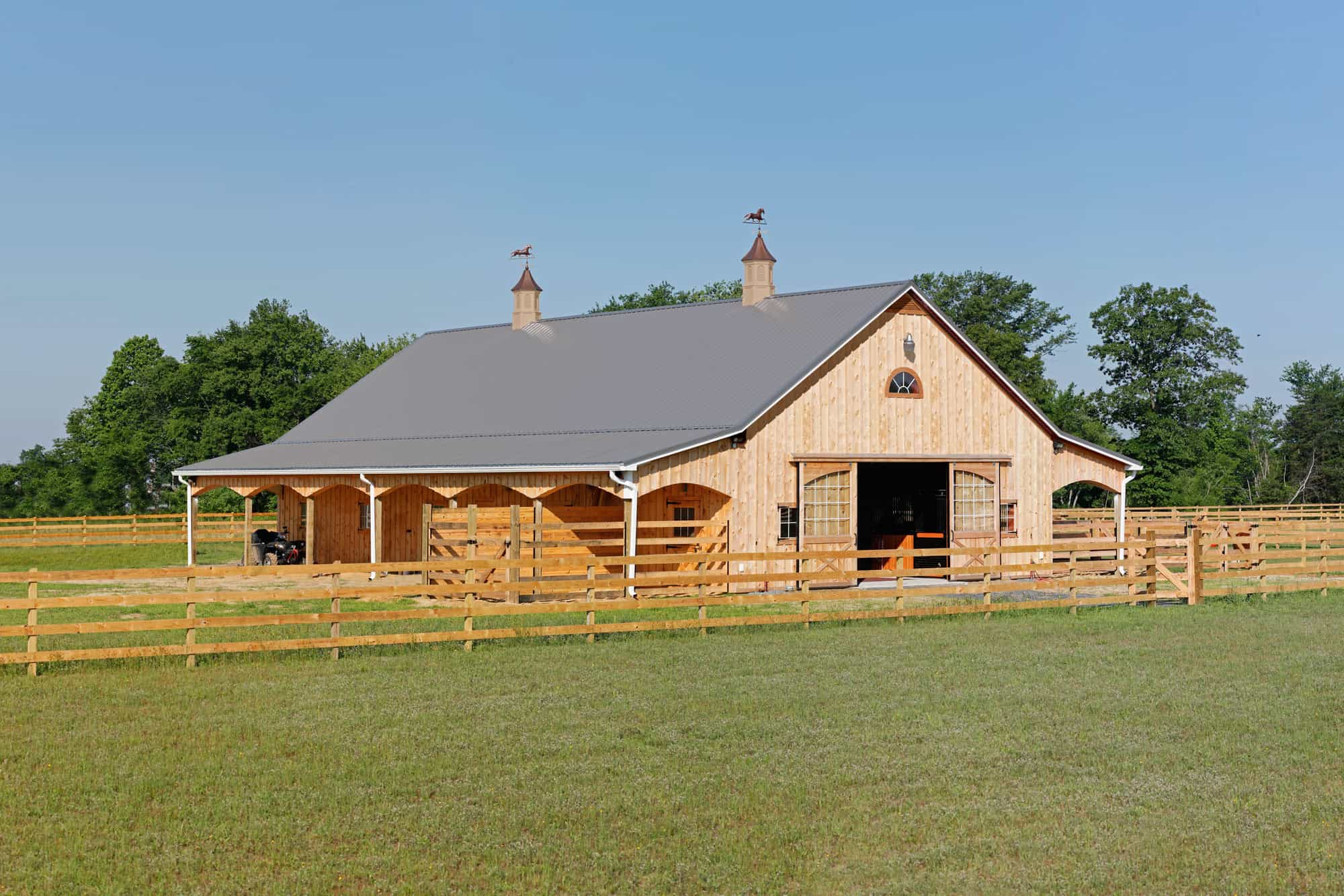 natural wood barn door cupola horse stalls