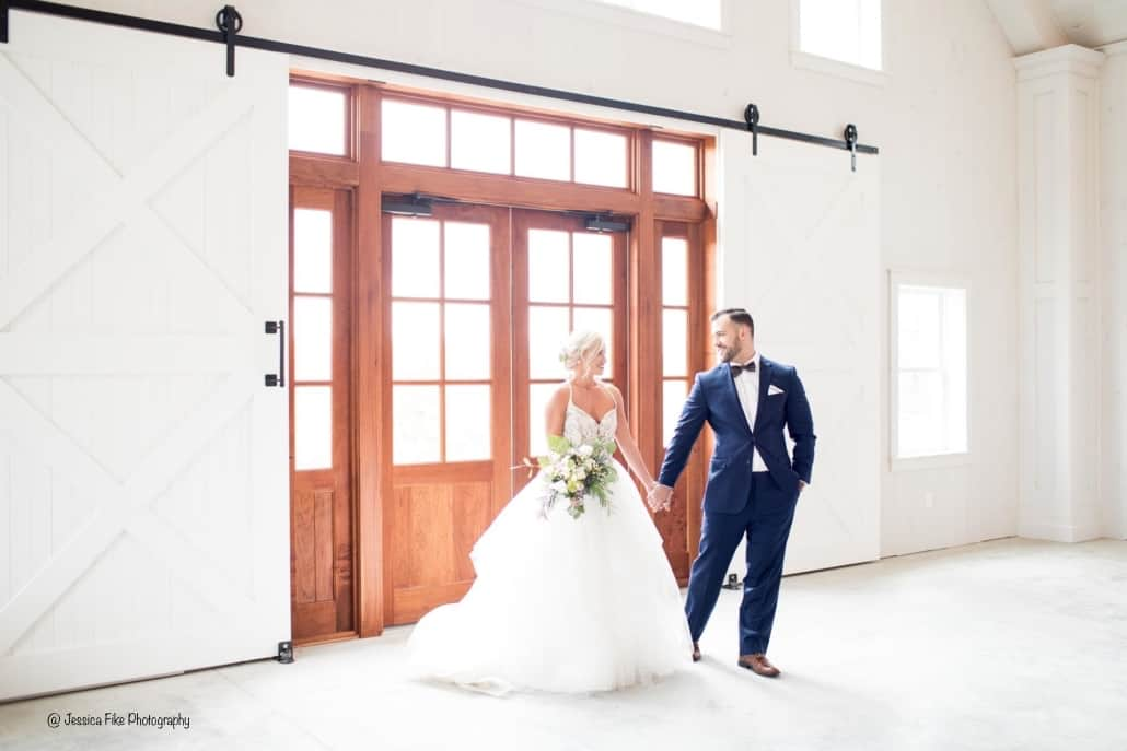 bride and groom barn doors party barn