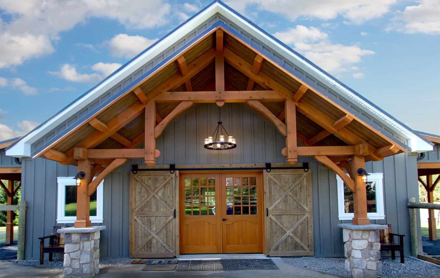 grand entryway mass timber barn doors