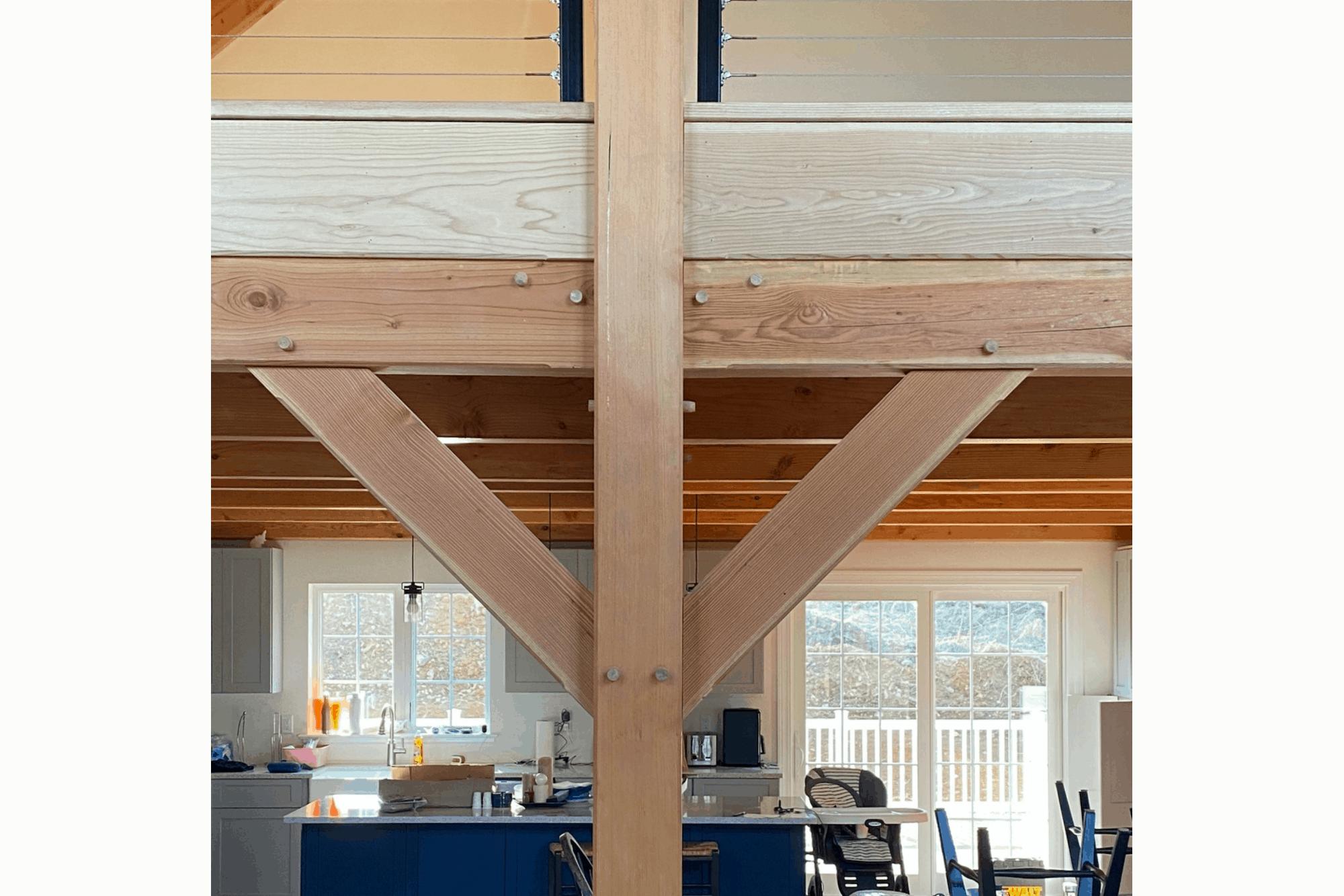 mass timber metal railing blue cabinets