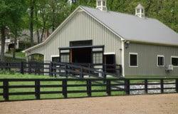 black fence green barn cupola