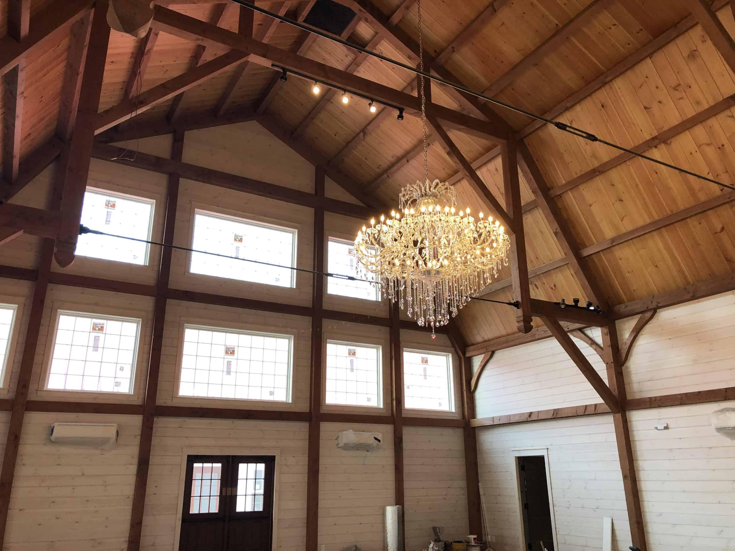 timber frame chandelier vaulted ceiling
